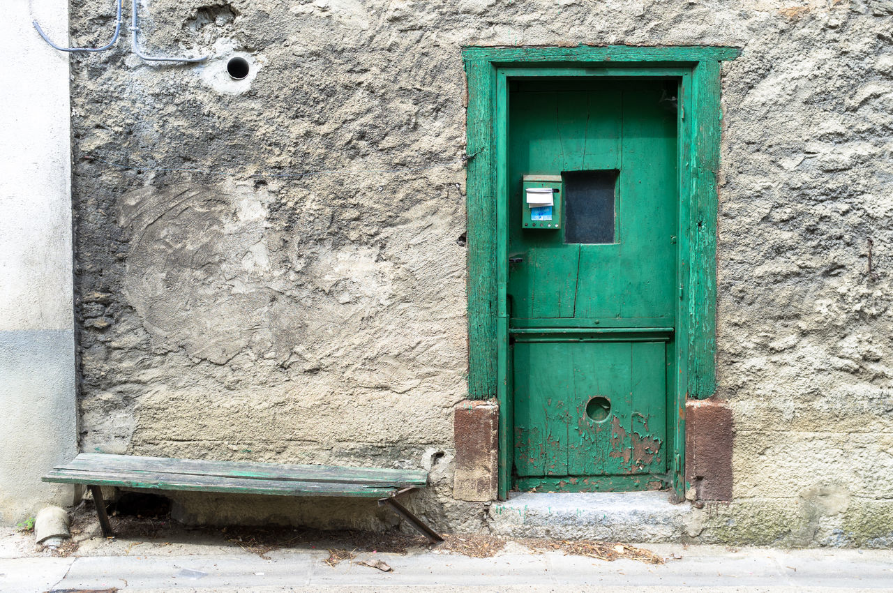 Architecture Building Exterior Rustic Rustic Style Closed Door Door Entrance House Languedoc Lapradelle-Puilaurence No People Outdoors Southern France Urban Decay Urban Fragments Urban Geometry Urban Landscape Urbanphotography Old Bench Bench Green Green Door Old Facade