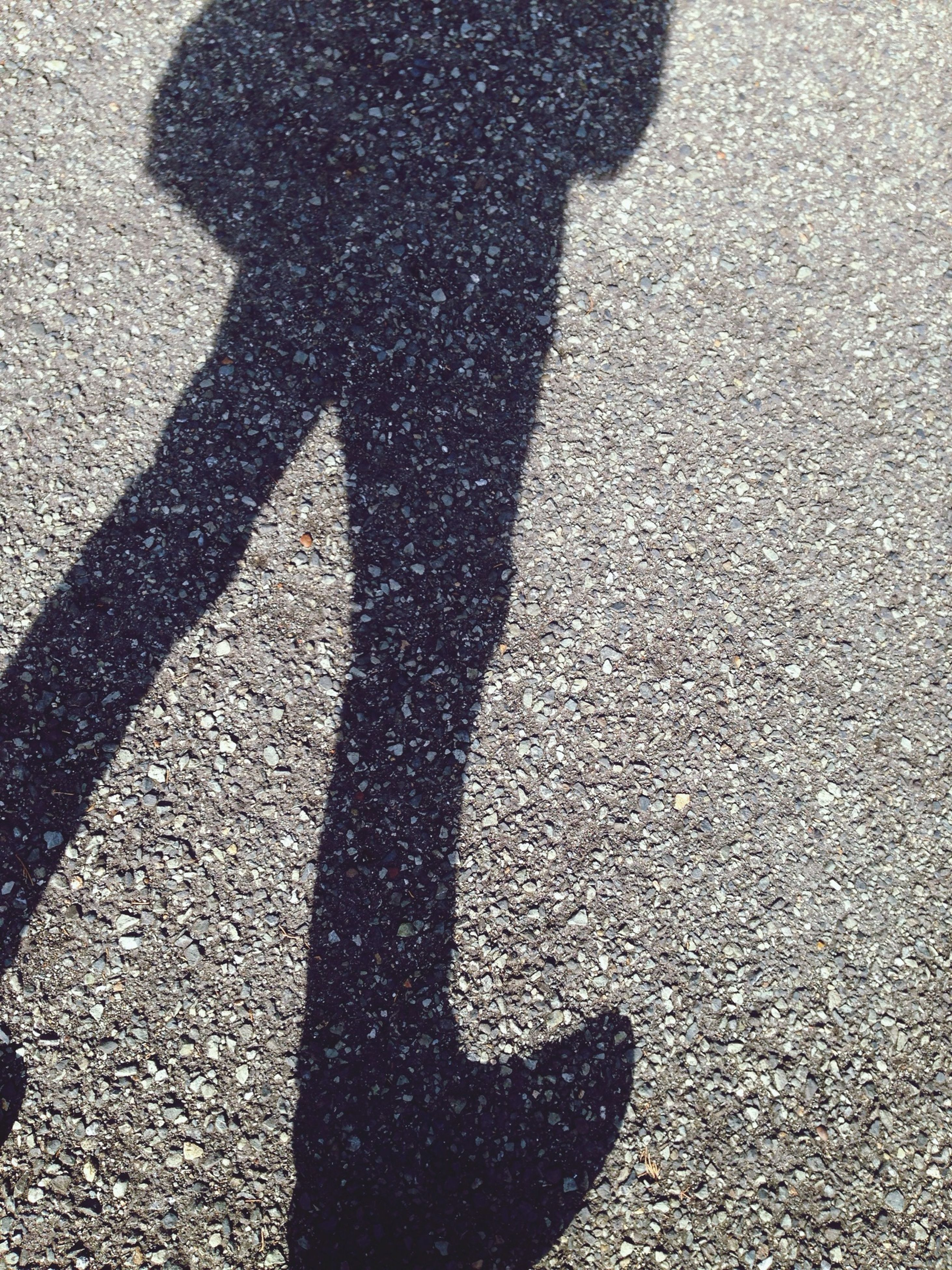 shadow, sunlight, focus on shadow, high angle view, street, lifestyles, leisure activity, road, asphalt, standing, unrecognizable person, men, outdoors, day, walking, silhouette, outline