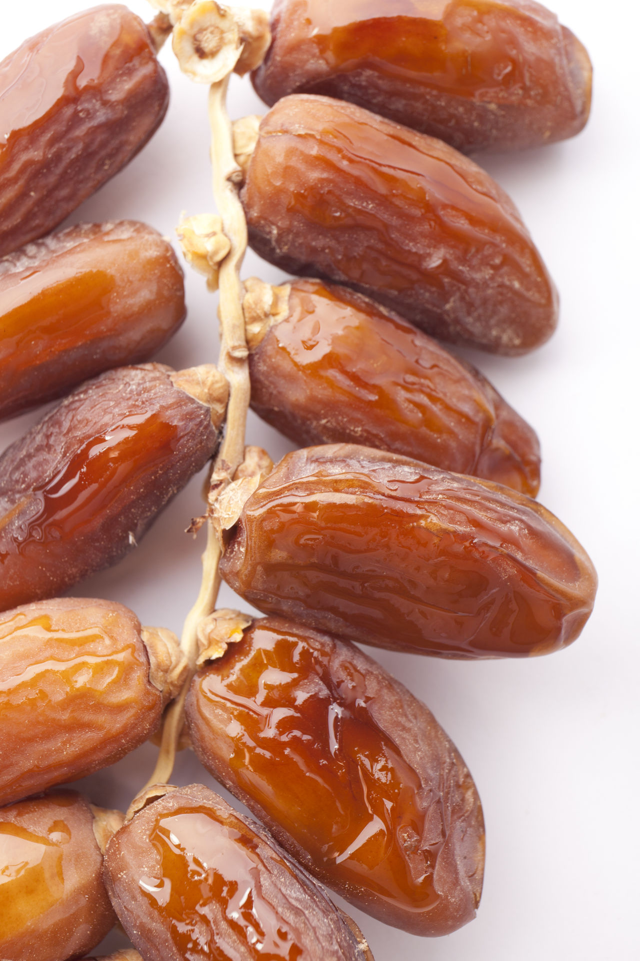 Date Fruit Close-up Color Image Date Fruit Day Dried Fruit Focus On Foreground Food Food And Drink Freshness Fruit Healthy Eating Indoors  Ingredient No People Photography Ready-to-eat Still Life Studio Shot Vertical White Background