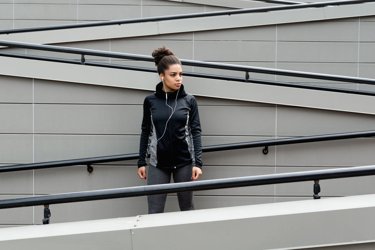 Athlete Built Structure Day Females Fit Fitness Front View Full Length Girl Healthy Lifestyle Lifestyles Mixed Race One One Person Outdoors People Real People Sport Clothes Steps And Staircases Training Woman Young Adult Young Women