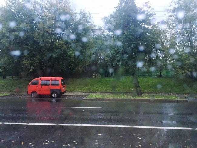 It's look like tiny world Car Red Car Road Road Empty Road Single Car Rain Rainy Days Raindrops No People Vehicle Small Car The Color Of Business
