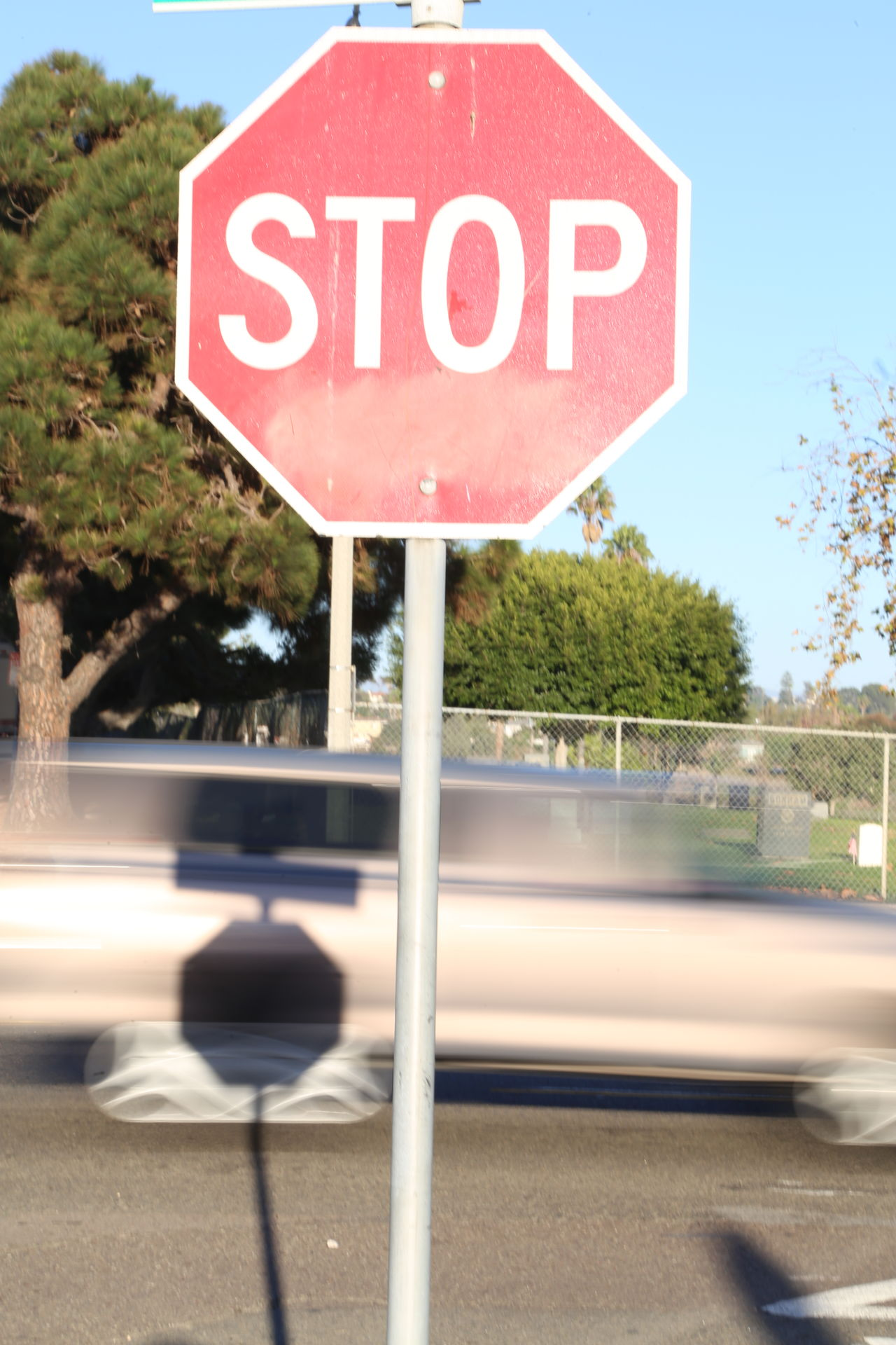 Communication Day Guidance Nature Outdoors Road Road Sign Sky Speeding Stop Sign Text Transportation