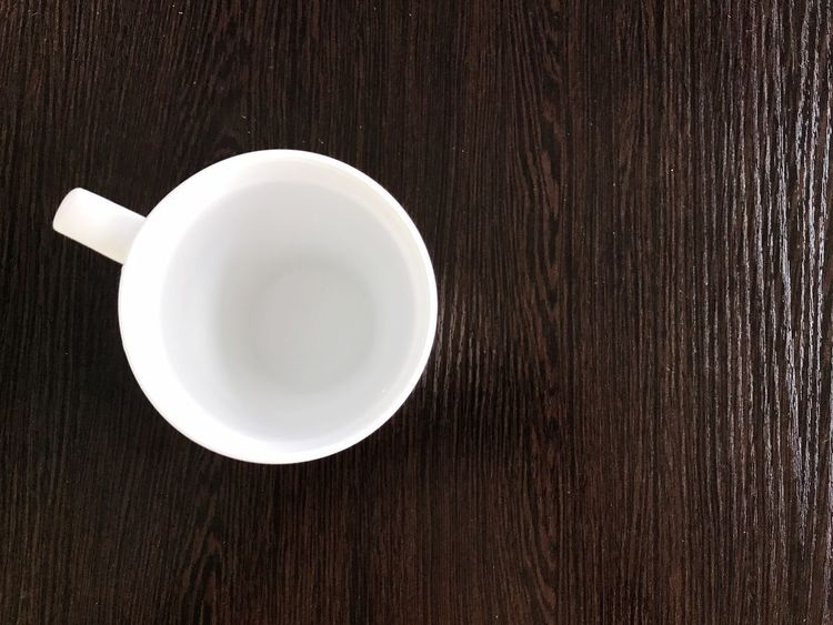 white cup plain water on brown background Food And Drink Drink Table Still Life Refreshment Coffee Cup Freshness High Angle View No People Close-up Plain Water White Cup Brown Background Hi Tea Dinner