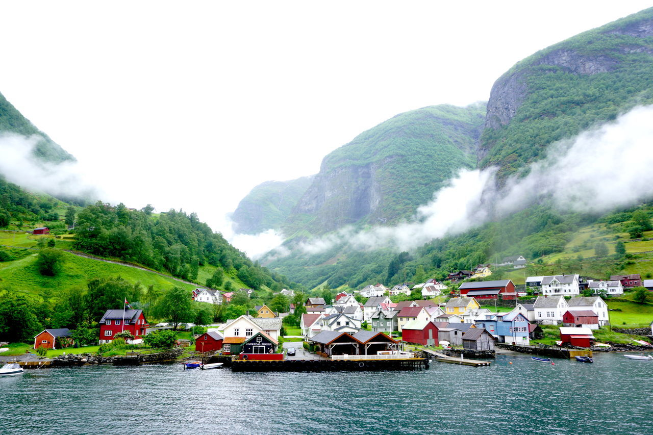 Magical little Norwegian village Beautiful Norway Scandinavia Travel Undredal Beauty In Nature Clear Sky Dreamlike Fjord Fjordnorway Fjørd Mountain Mountain Range Nature Nautical Vessel Outdoors River Scandanavia Scenics Sky Surrealism Tranquility Tree Village Water