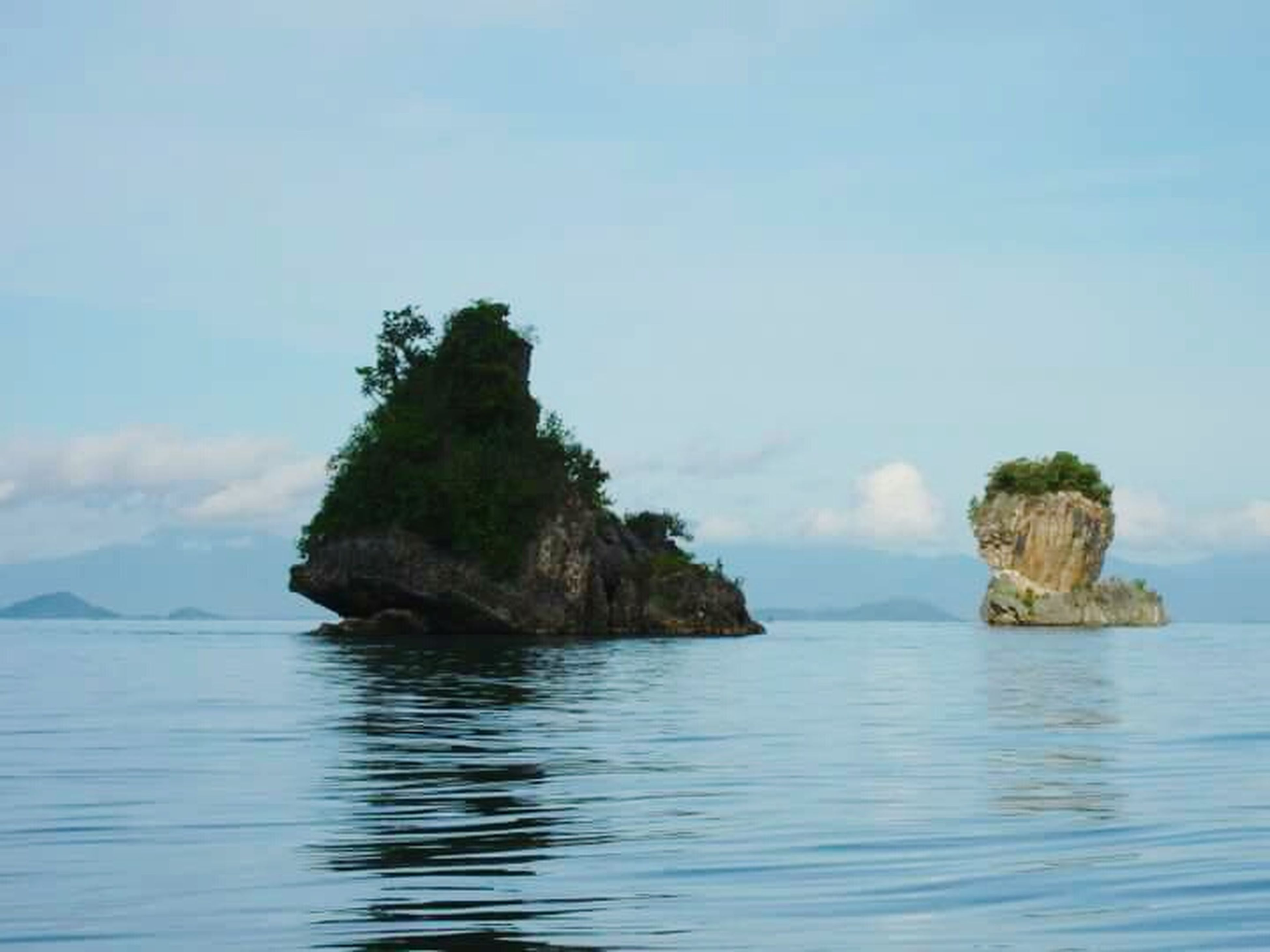 water, sea, tranquil scene, tranquility, waterfront, scenics, beauty in nature, sky, nature, rock - object, rock formation, horizon over water, idyllic, blue, rock, calm, cliff, day, outdoors, rippled