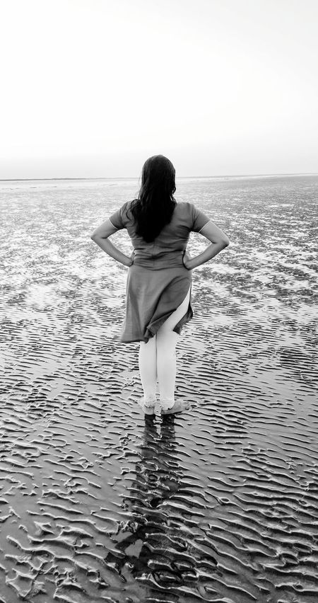 Mobile Conversations sea shore One Woman Only One Person Beach Women Human Back Reflux Water Sea Outdoors First Eyeem Photo EyeEmNewHere Women Around The World