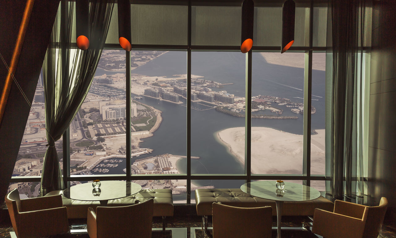 View from the 52nd floor of the Etihad Tower Architecture City Cityscape Day No People Outdoors Sky Skyscraper Sunset Travel Travel Destinations Urban Skyline Water Window