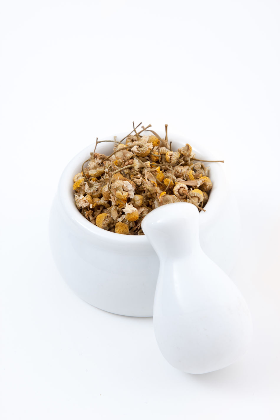Fine dried chamomile in mortar Camomile Camomile Tea Chamomile Chamomile Tea Healing Plant Herb Herbalism Isolated White Background Mortar Mortar And Pestle Natural Cure Natural Healing Plant Natural Medicine Nature Cured Naturopathy White Background