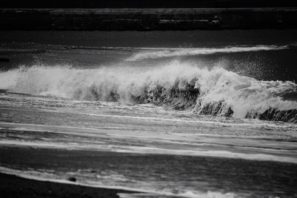 Breaking.... Sea Wave Motion Water Surf Beach Nature Force No People Crash Day Outdoors Power In Nature Sand Breaking RISK Beauty In Nature Blackandwhite Photography Nature Blackandwhite Black And White