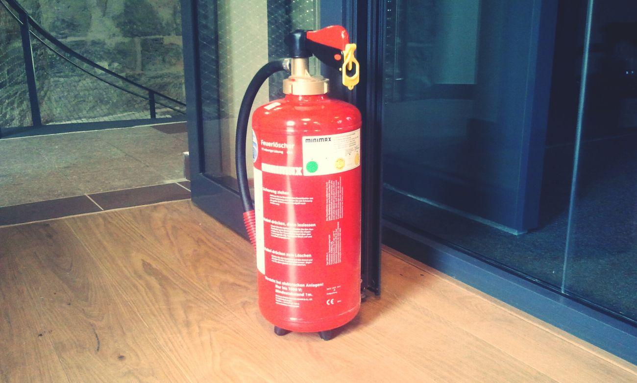 Feuerlöscher als Türstopper