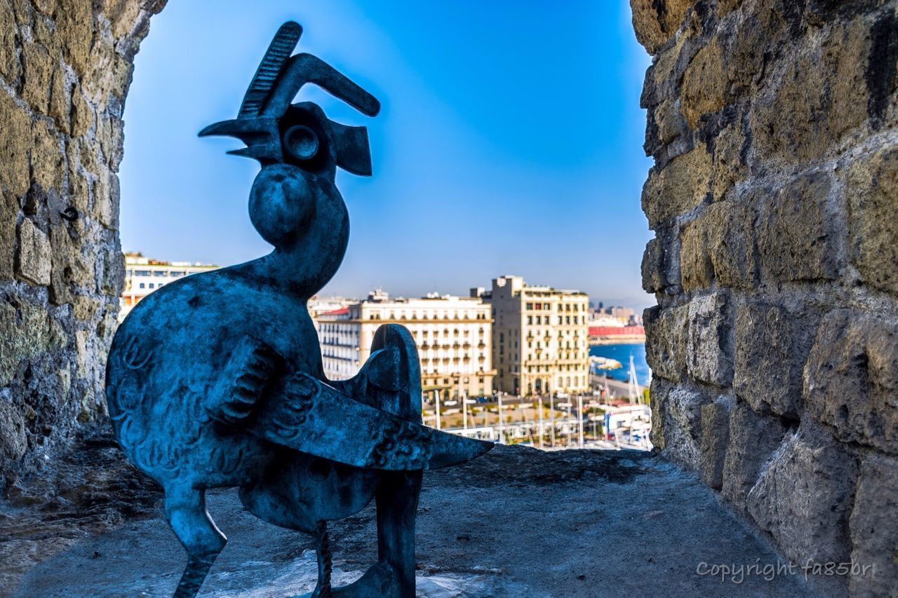 Castel dell'Ovo Sculpture Statue Creativity Art And Craft Animal Representation Sky No People Outdoors Architecture Sculpted Rooster Day Gargoyle