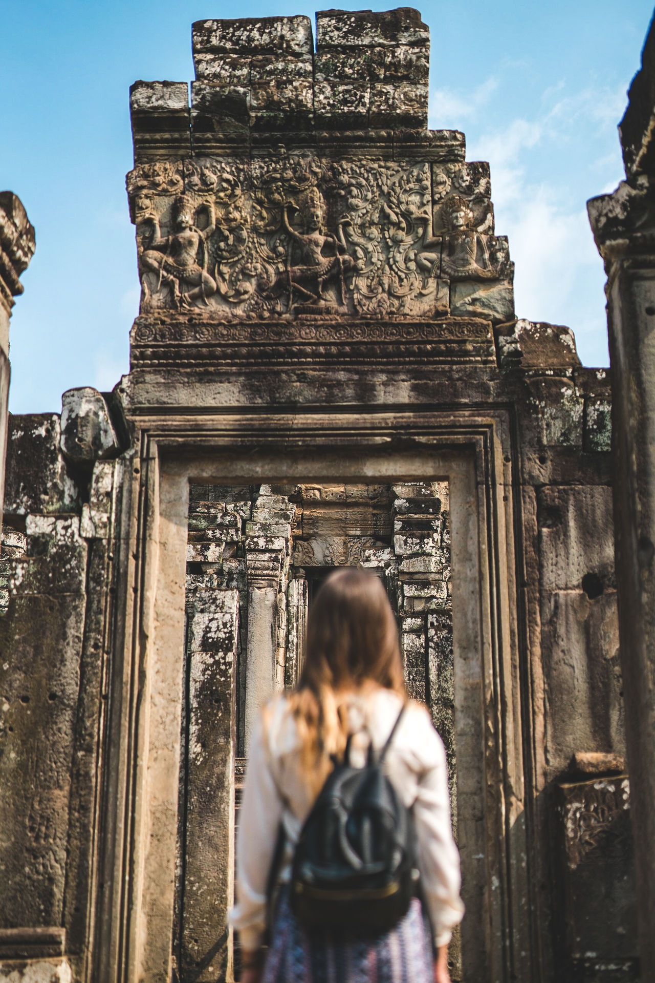 Feels like when the hero is about to enter the temple and find the final boss. Travel Destinations Architecture Built Structure Adult Day Building Exterior Low Angle View Real Life Travel Culture Showcase May Travel Photography ASIA Cambodia Tourism Temple Wonder Of The World Ancient Civilization Spirituality Religion Old Ruin Full Length
