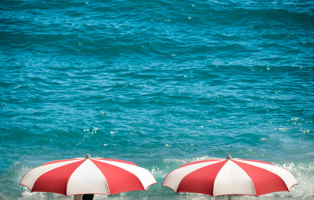 Beach Beach Umbrella Beauty In Nature Blue Centered Day Mediterranean Sea Nature No People Outdoors Parasol Protection Red Sea Summer Sunlight Tourism Turquoise Colored Vacations Water
