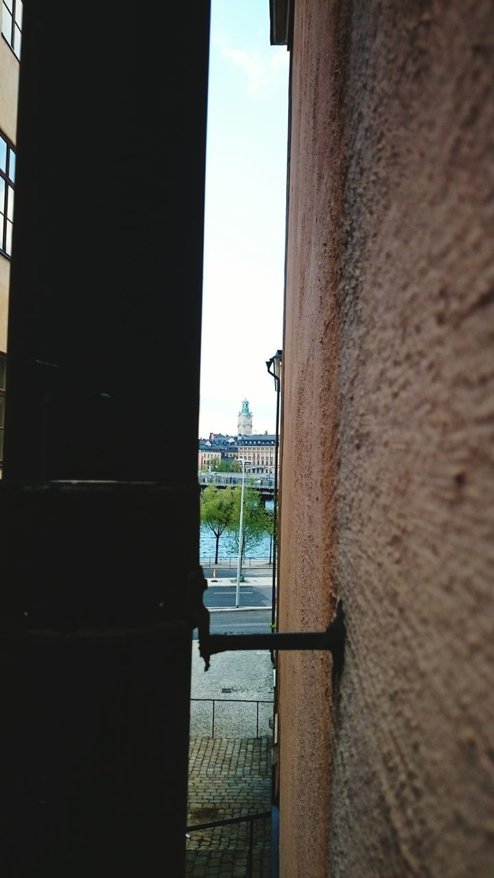 Tower Viewed Through Gate Against Sky