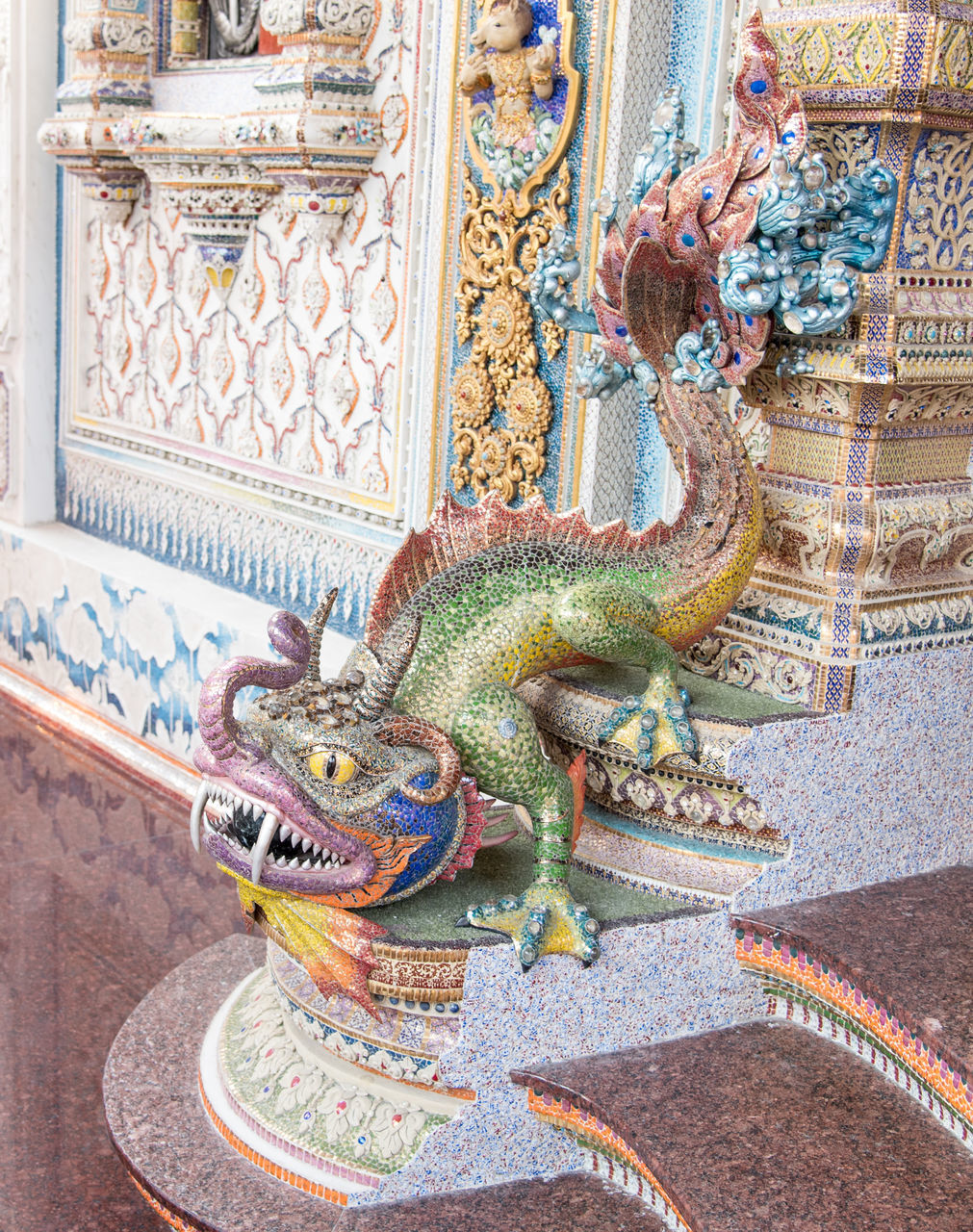 animal representation, art and craft, dragon, statue, sculpture, ornate, religion, no people, place of worship, chinese dragon, day, spirituality, multi colored, indoors, architecture, close-up