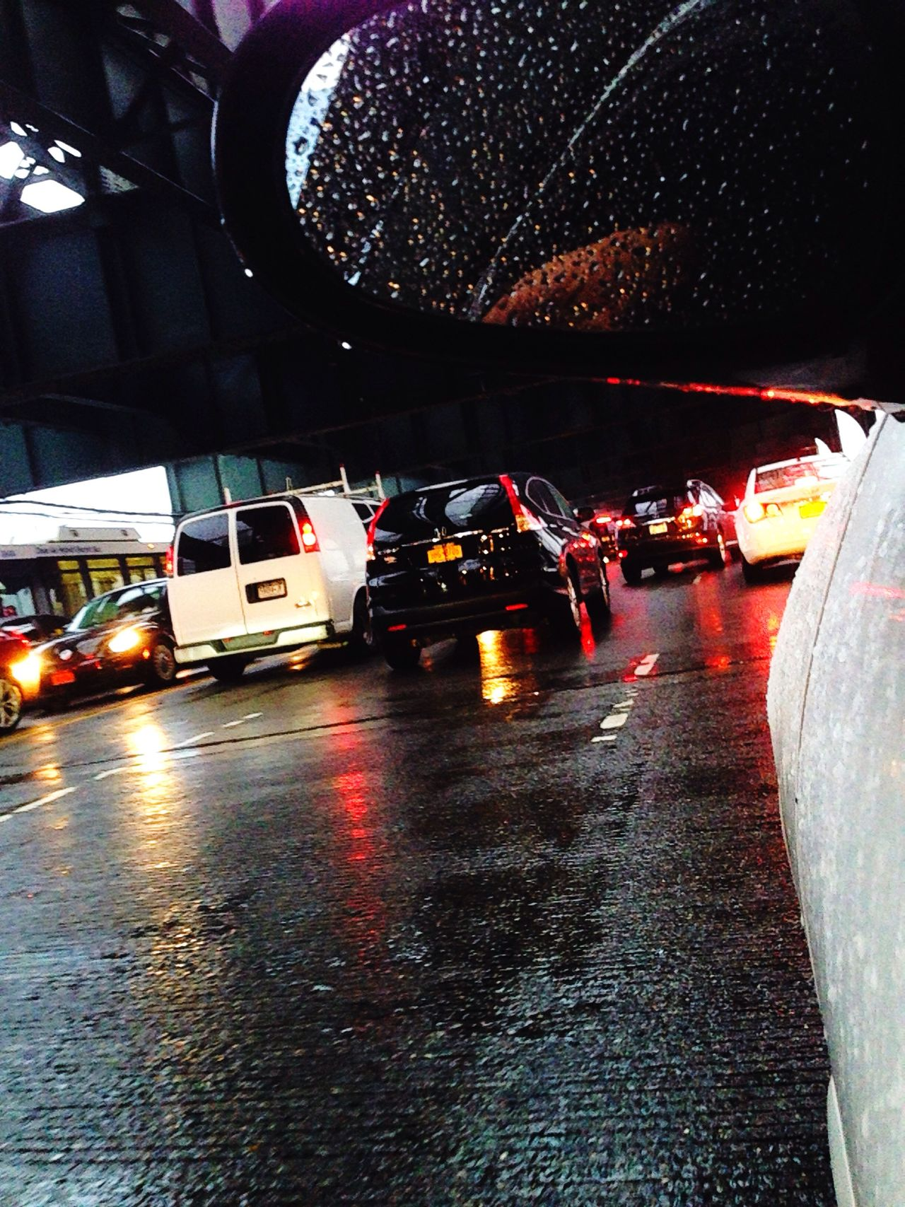 Driving in the rain across a bridge in heavy rush hour traffic, New York City on New York City streets. Car Transportation Mode Of Transport Traffic Road City Life Rush Hour