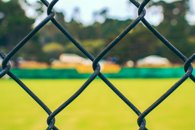 Chain Link Fence Chainlink Chainlink Fence Close-up Cropped Fence Focus On Foreground Full Frame Green Lawn Bowling Metal No People Park - Man Made Space Protection Safety Security Sport Sports