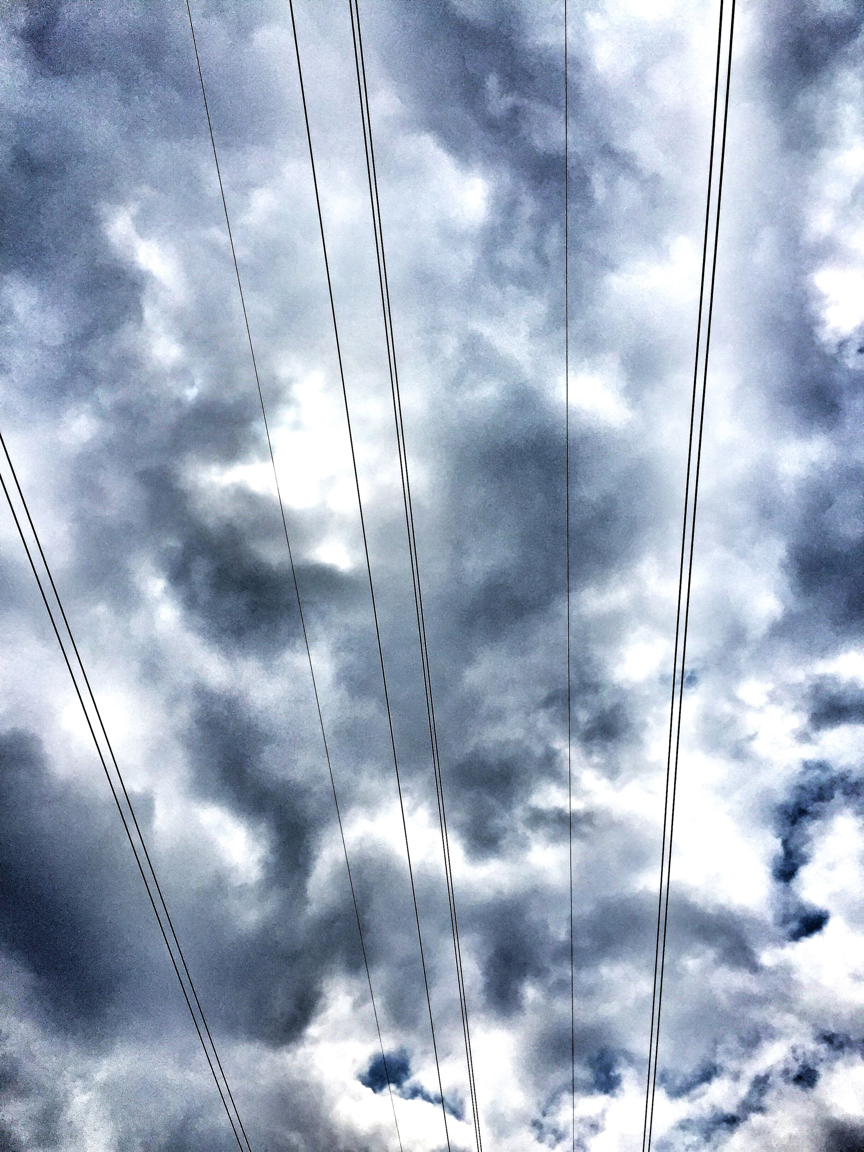 sky, low angle view, cloud - sky, cloudy, power line, cable, electricity, connection, cloud, power supply, electricity pylon, technology, weather, fuel and power generation, overcast, day, outdoors, no people, power cable, nature