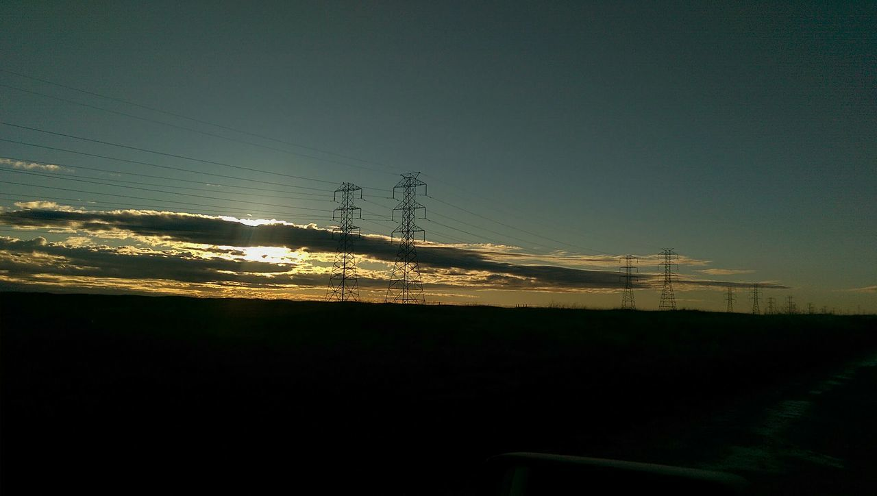 electricity pylon, cable, electricity, connection, power line, landscape, fuel and power generation, no people, silhouette, power supply, field, nature, outdoors, sky, sunset, clear sky, day, technology