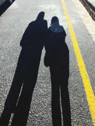 Lovers dont finally meet. They with each other all along - Jalludin Rumi Shadow Road Marking Road Focus On Shadow Men Real People Street Asphalt Togetherness High Angle View Transportation Day Lifestyles Outdoors Sunlight Standing Yellow Women Adult Adults Only rumi