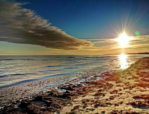 Beach Sunset Sand Sea Nature Scenics Outdoors Beauty In Nature Water Sky Sun Travel Destinations Sunlight No People Tranquility Summer Cold Temperature Landscape Vacations Day The Week On EyeEm