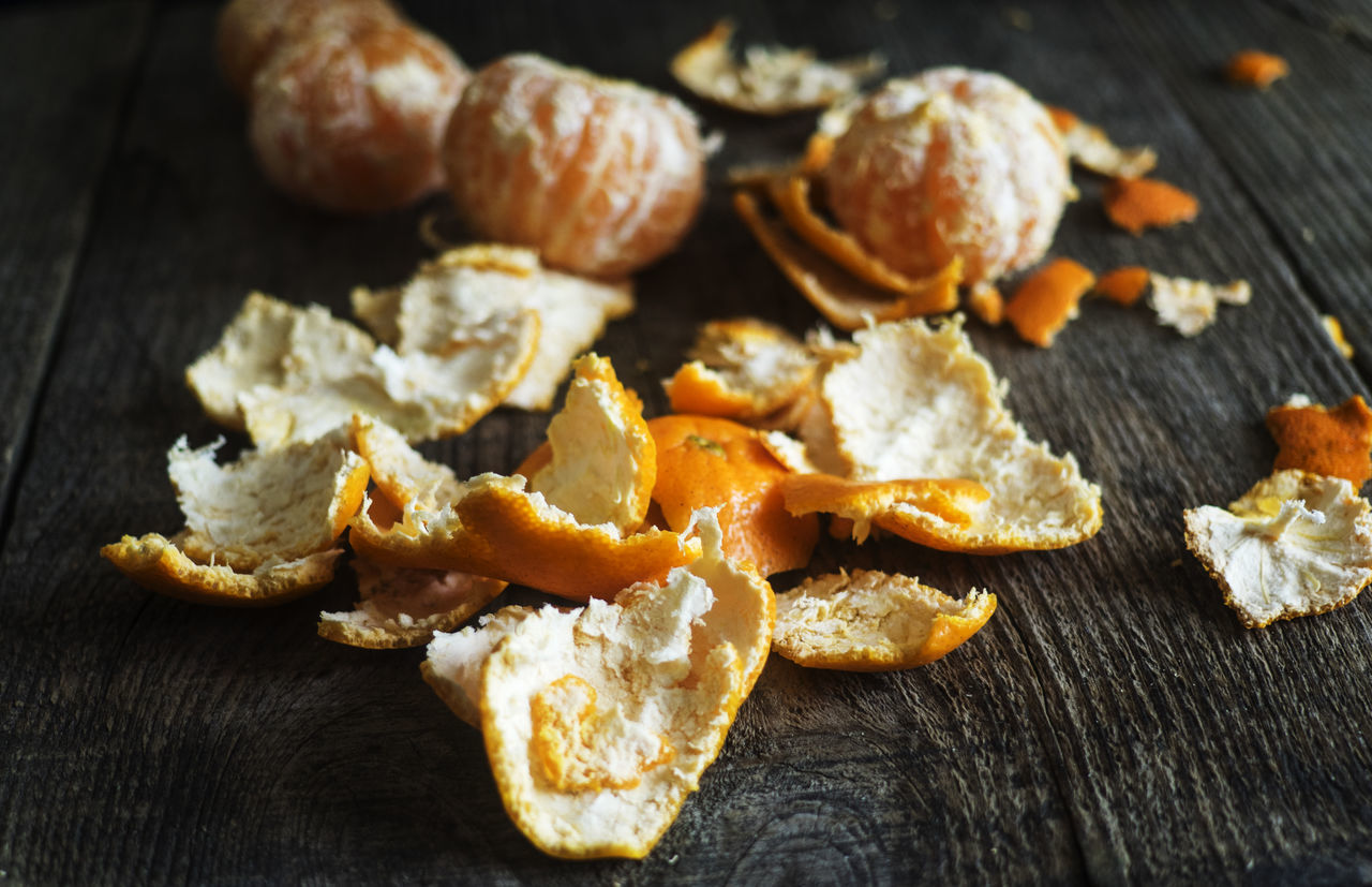 tangerine peel on old wooden background. slective focus Background Close-up Focus Food Food And Drink Freshness In A Row Large Group Of Objects No People Old Peel Peel Slective Tangerine Wooden