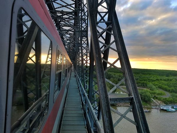 Bridge - Man Made Structure Metal Cloud - Sky Built Structure Sunset Transportation The Way Forward Railroad Track Train - Vehicle Travel Transportation Rail Transportation Day Sky