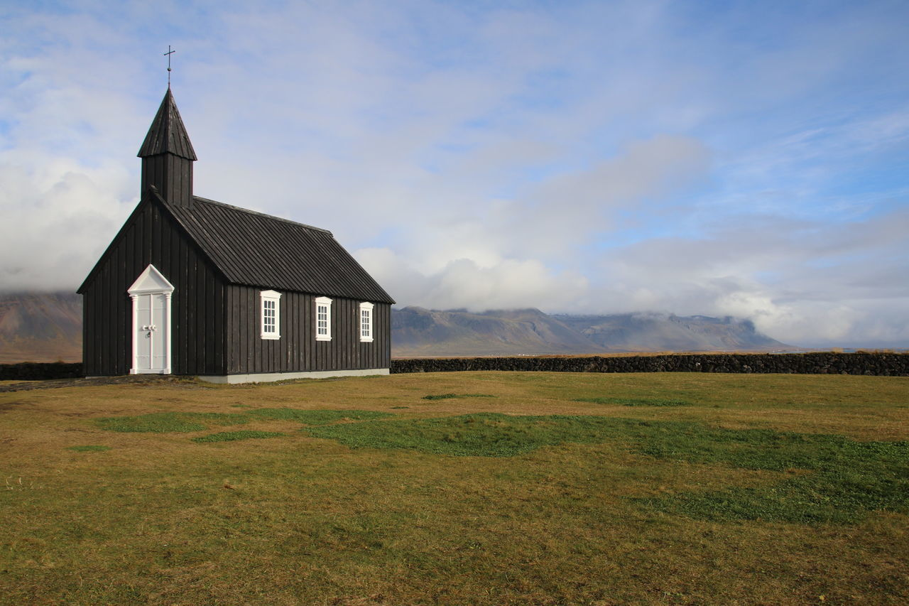 field, architecture, built structure, sky, no people, spirituality, landscape, religion, day, grass, place of worship, building exterior, outdoors, nature