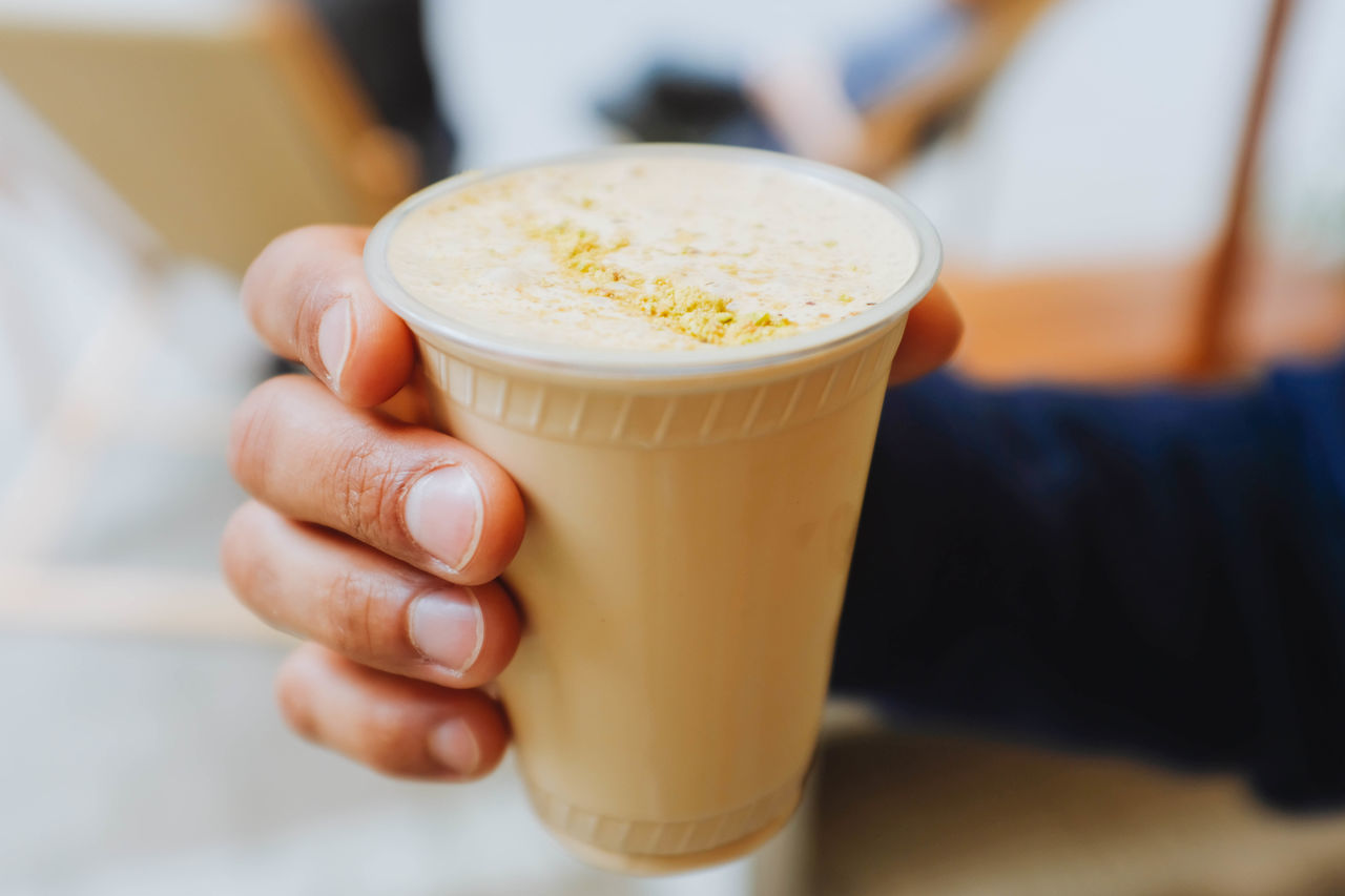 Close-up Coffee - Drink Day Drink Focus On Foreground Food Food And Drink Freshness Frothy Drink Healthy Eating Holding Human Body Part Human Hand Indoors  Lifestyles One Person People Ready-to-eat Real People Refreshment Women