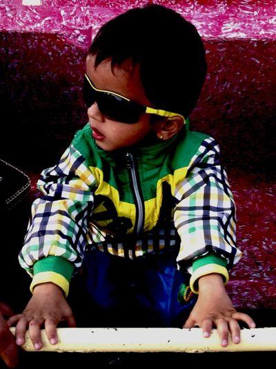 My son having fun in chitwan fastival NEPAL