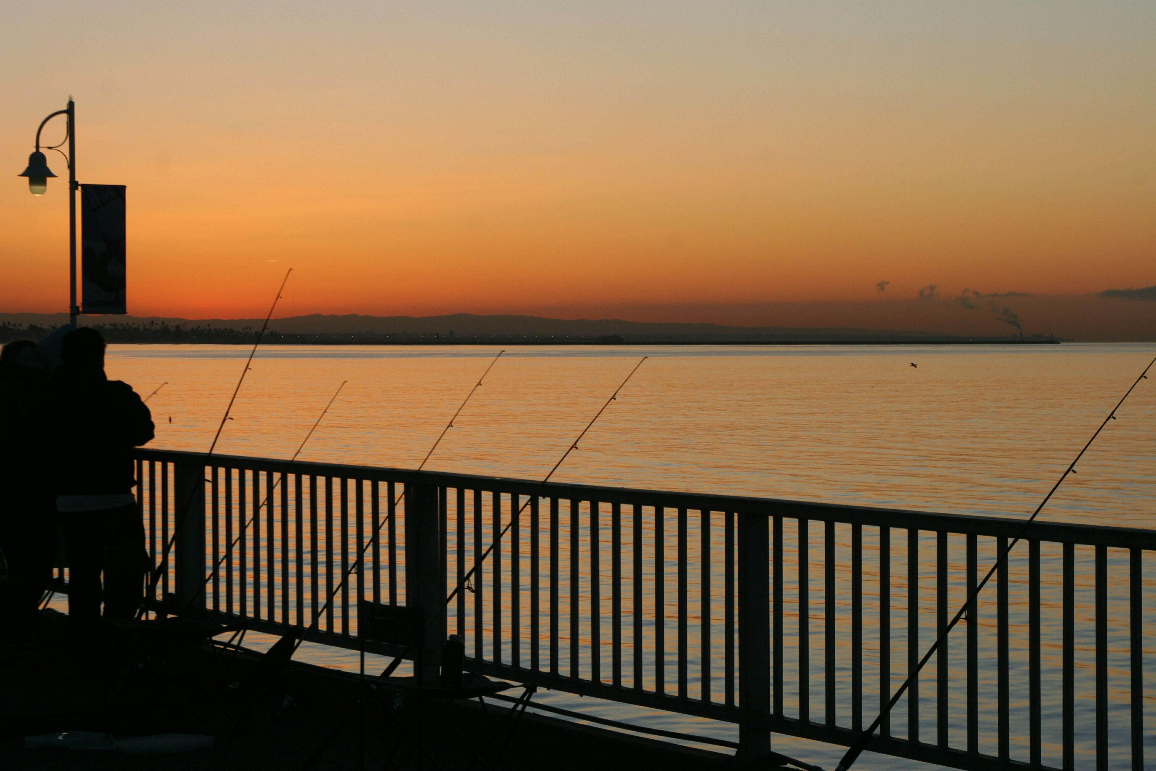 sunset, water, orange color, sea, silhouette, clear sky, scenics, tranquil scene, tranquility, copy space, beauty in nature, railing, nature, sky, idyllic, pier, lake, river, outdoors, sun