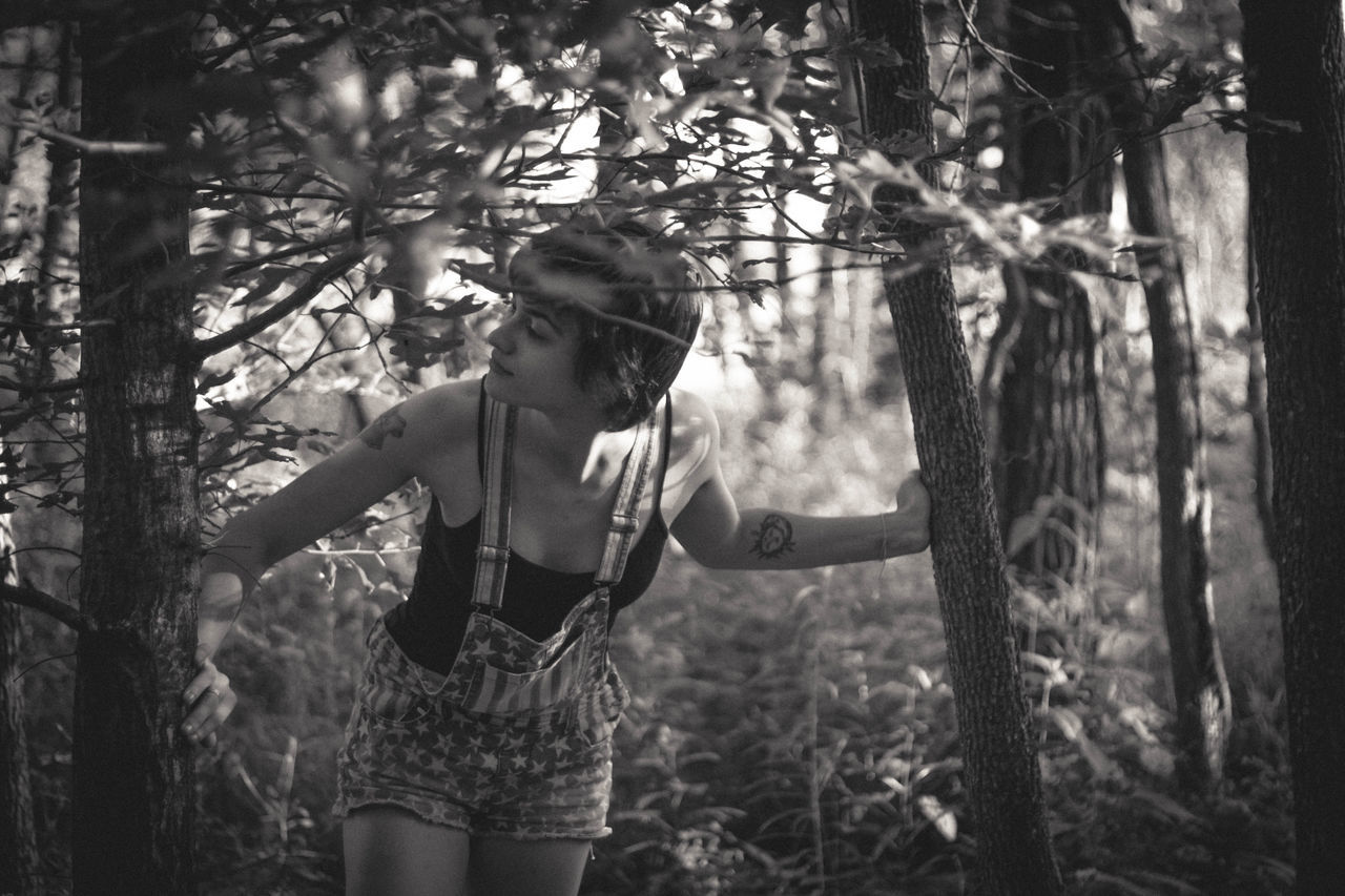 Anybody out there? Black And White Black And White Portrait Casual Clothing Day Exploring Growth Hanging Out Intriguing Leisure Activity Lifestyles Nature Outdoors Peeking Playful Playful Portrait Tree Natural Light Portrait