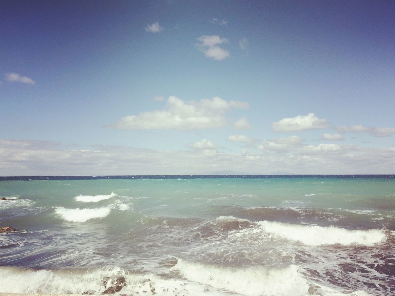 sea, horizon over water, beauty in nature, scenics, water, nature, sky, tranquility, no people, tranquil scene, cloud - sky, beach, outdoors, day, wave, blue