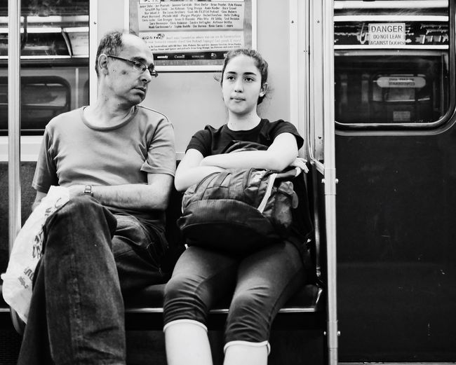 EyeEm Selects Sitting Two People Train - Vehicle Real People Casual Clothing Lifestyles Looking At Camera Transportation Front View Portrait Public Transportation Subway Train Day Indoors  Young Adult Young Women People VSCO Snapseed Streetphotography Blackandwhite