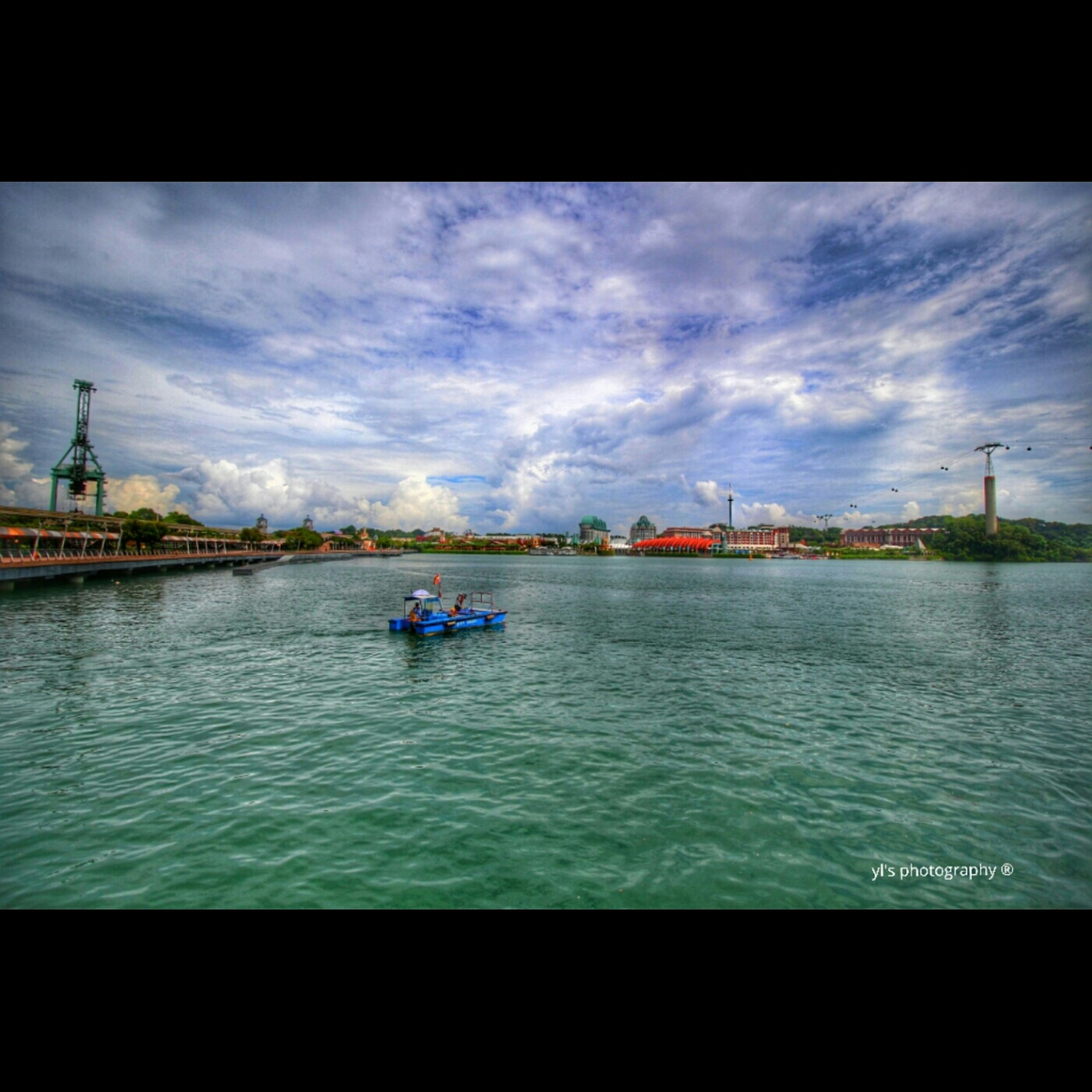 water, nautical vessel, sky, transportation, cloud - sky, mode of transport, transfer print, boat, men, lifestyles, waterfront, leisure activity, cloud, auto post production filter, river, cloudy, rippled, sea