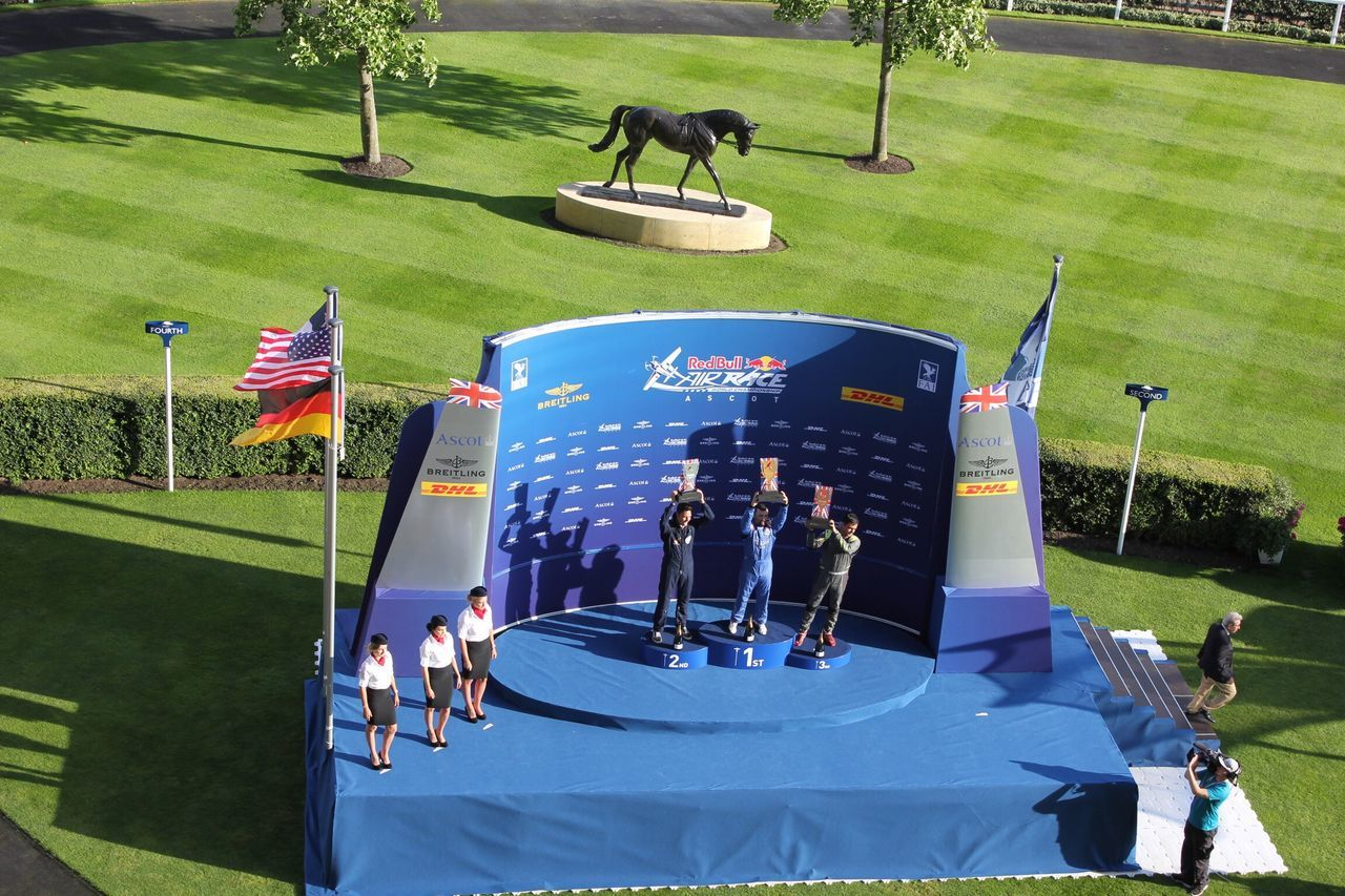 Red Bull Air Race Podium at Ascot Crowds Spectacular Spectator Spectators , UK Sport Watching Green Color Teamwork Event RedBull Redbullairrace Redbullairrace2016 Pilot Aeroplane Winner FirstPlace Racing Podium Trophy First Eyeem Photo Horse Ascot Ascot Racecourse