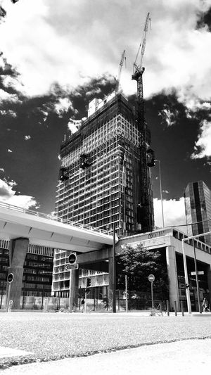 Under Construction Architecture Built Structure Building Exterior Sky Low Angle View Day Outdoors Cloud - Sky No People City Blackandwhite Photography Blackandwhite Black And White Black & White Black&white Black And White Photography Architecture Blackandwhitephotography Black And White Collection  IPhoneography Iphone6splus Building Buildings & Sky Construction