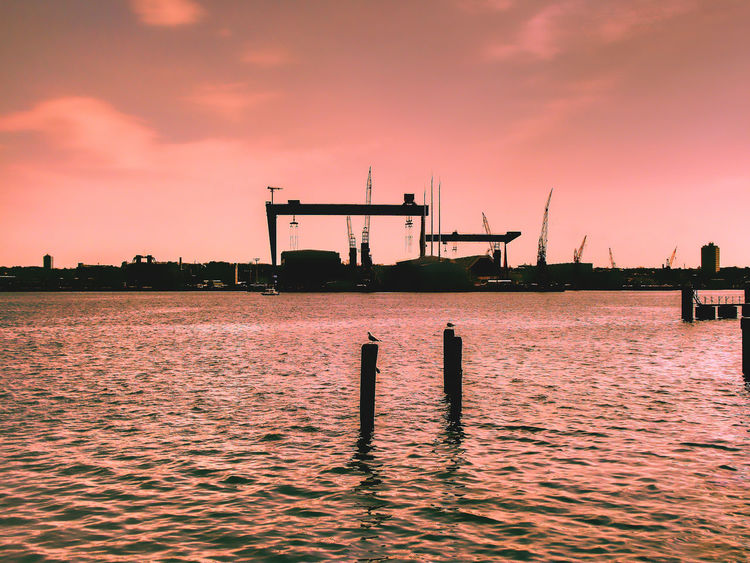Architecture Beauty In Nature Bird Building Exterior Built Structure Cloud - Sky Harbour Harbour View Idyllic Kiel Nature Reflection Rippled Scenics Sea Ship Building Shipyard Showcase April Silhouette Sky Sunset Tranquil Scene Tranquility Water Waterfront