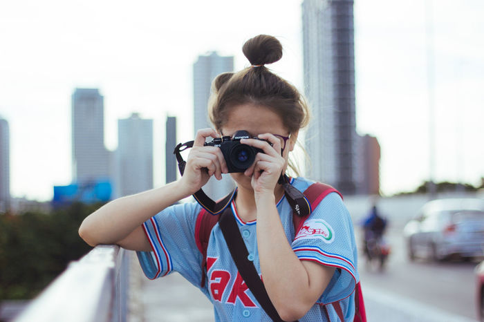 Photography Themes Young Adult City Photographing One Young Woman Only Adult One Woman Only Camera - Photographic Equipment Young Women Front View Adults Only One Person Only Women People Women Headphones Photographer Skyscraper City Life Day EyeEm Selects