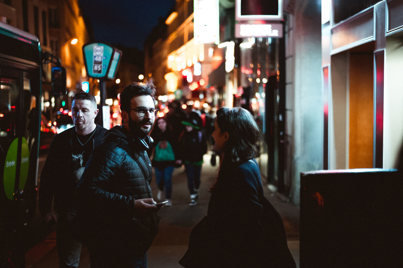 Illuminated Night City City Life Architecture Men Built Structure Large Group Of People Real People Building Exterior Adult People Adults Only Outdoors The Portraitist - 2017 EyeEm Awards Young Adult The Photojournalist - 2017 EyeEm Awards The Street Photographer - 2017 EyeEm Awards