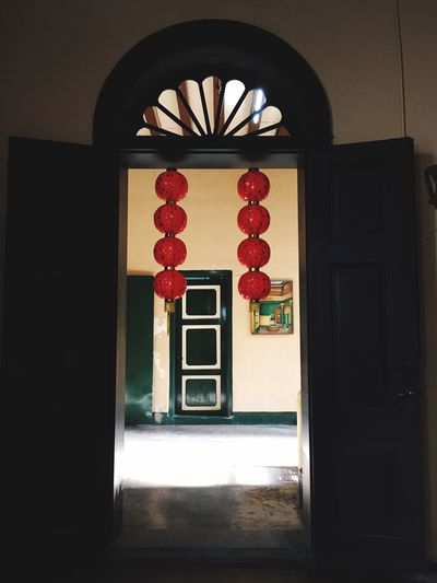 The door EyeEm Selects Culture Heritage Architecture Culture And Tradition Tjongafiemansion Chinese Lantern Door Built Structure Architecture No People Indoors  Doorway Building Exterior Multi Colored