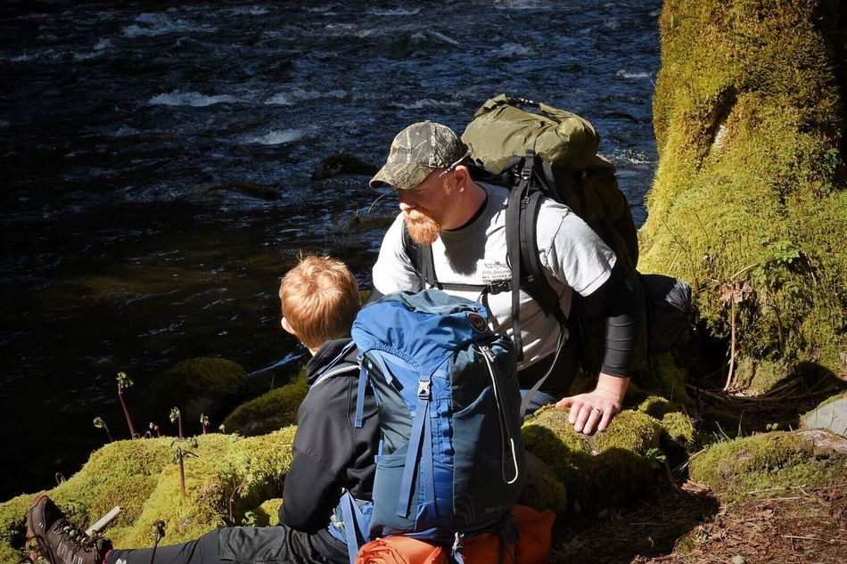 Two People Adventure Togetherness Senior Adult Senior Men Backpack Adult Hiking Retirement Day Leisure Activity People Bonding Senior Women Vacations Outdoors Weekend Activities Men Nature Lifestyles Riverside Fatherhood Moments Father & Son Memories