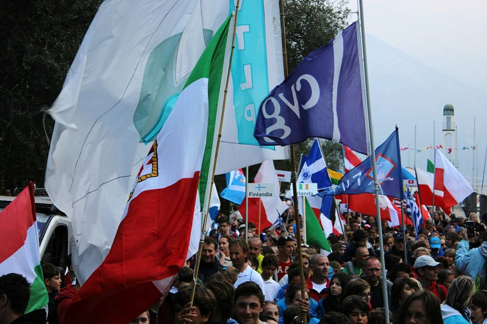 Flag Large Group Of People Sky Day People Reacing Meeting The Biggest Regatta In World Flags Garda Sail Sailing Sport Guinness World Record Real People Unity Built Structure Watching Outdoors Patriotism Pride