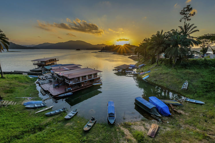 Amazing view of sunset in lake kenyir with beautiful boat and golden sky background Boats⛵️ Kenyir Lake Sunlight Sunset_collection Beauty In Nature Boat Day Evening Fishing, Angling, Trawling, Trolling, Seining, Ice Fishing, Catching Fish High Angle View Houseboat Lake Landscape Nature Outdoors Scenics Sky Sunrise Sunset Tranquil Scene Tranquility Transportation Tree Trully Asia Water