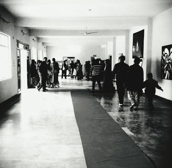 EyeEm Selects People Large Group Of People Full Length Politics And Government Indoors  Young Adult Day Adults Only Auditoriumbuilding Auditorium Blackandwhite Photography Blak And White Standing Adult Men