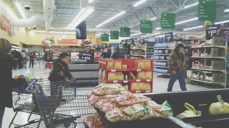 Real People Retail  Men Indoors  Women Large Group Of People People Adult Day Supermarket Walmart Architecture Indoors  Shelf Illuminated Business Finance And Industry