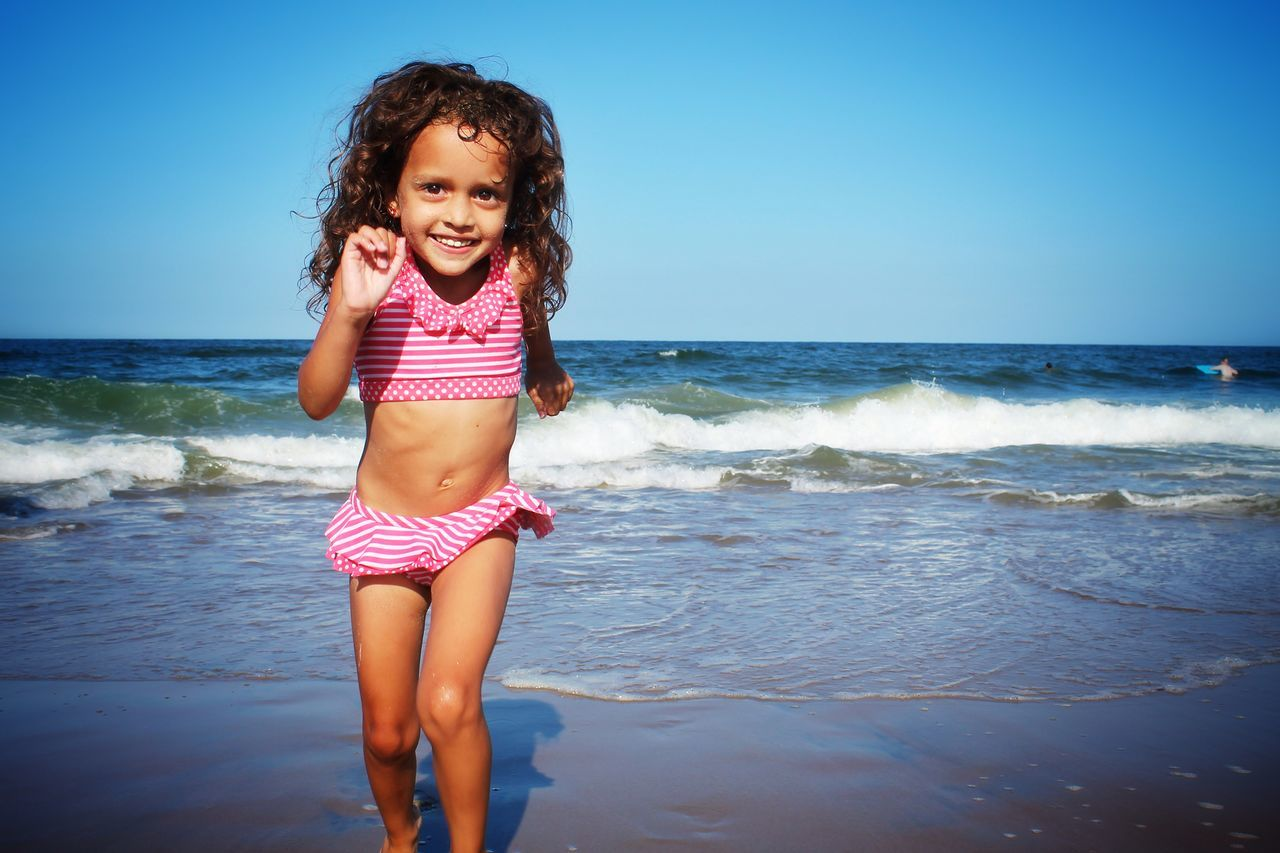 Beautiful stock photos of girl, Beach, Beauty In Nature, Blue, Childhood