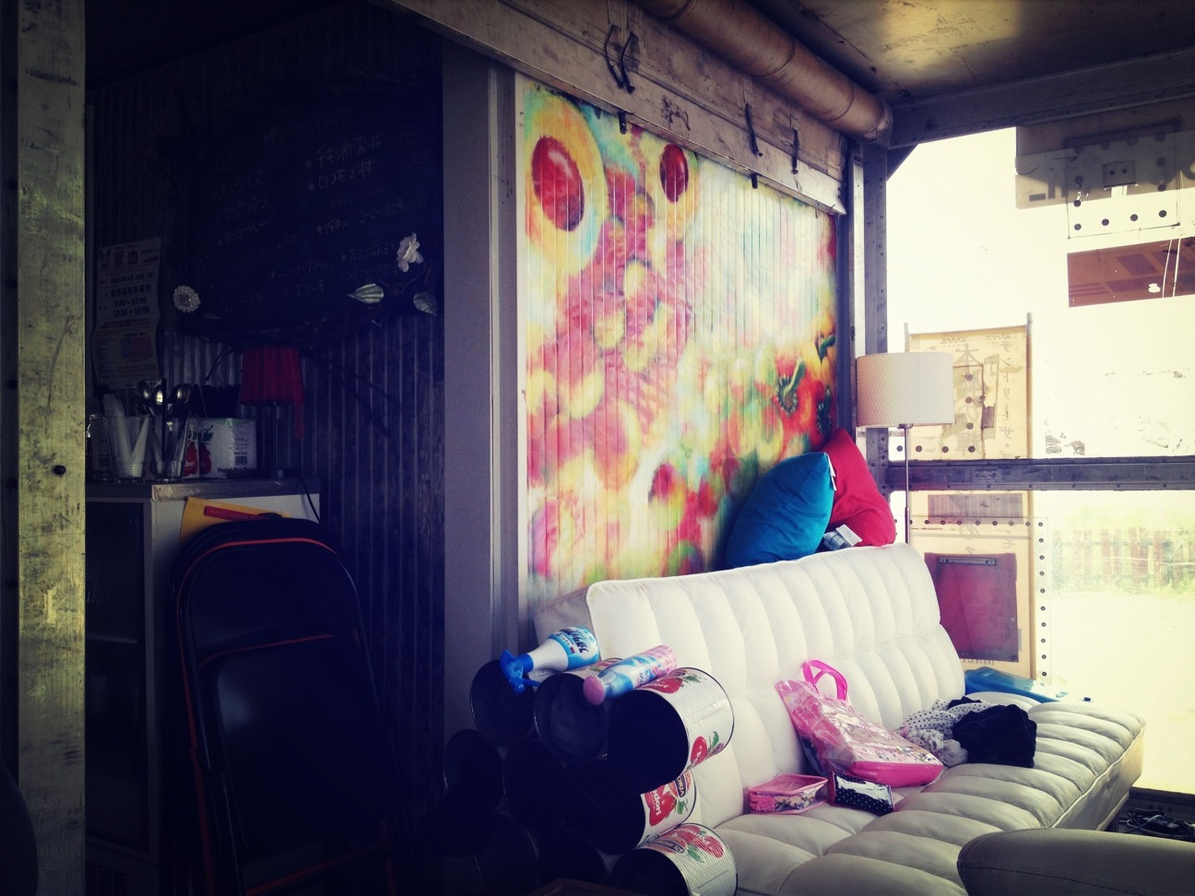 indoors, home interior, curtain, window, absence, multi colored, house, built structure, book, chair, architecture, clothing, bed, bedroom, sofa, open, graffiti, empty, day, domestic room
