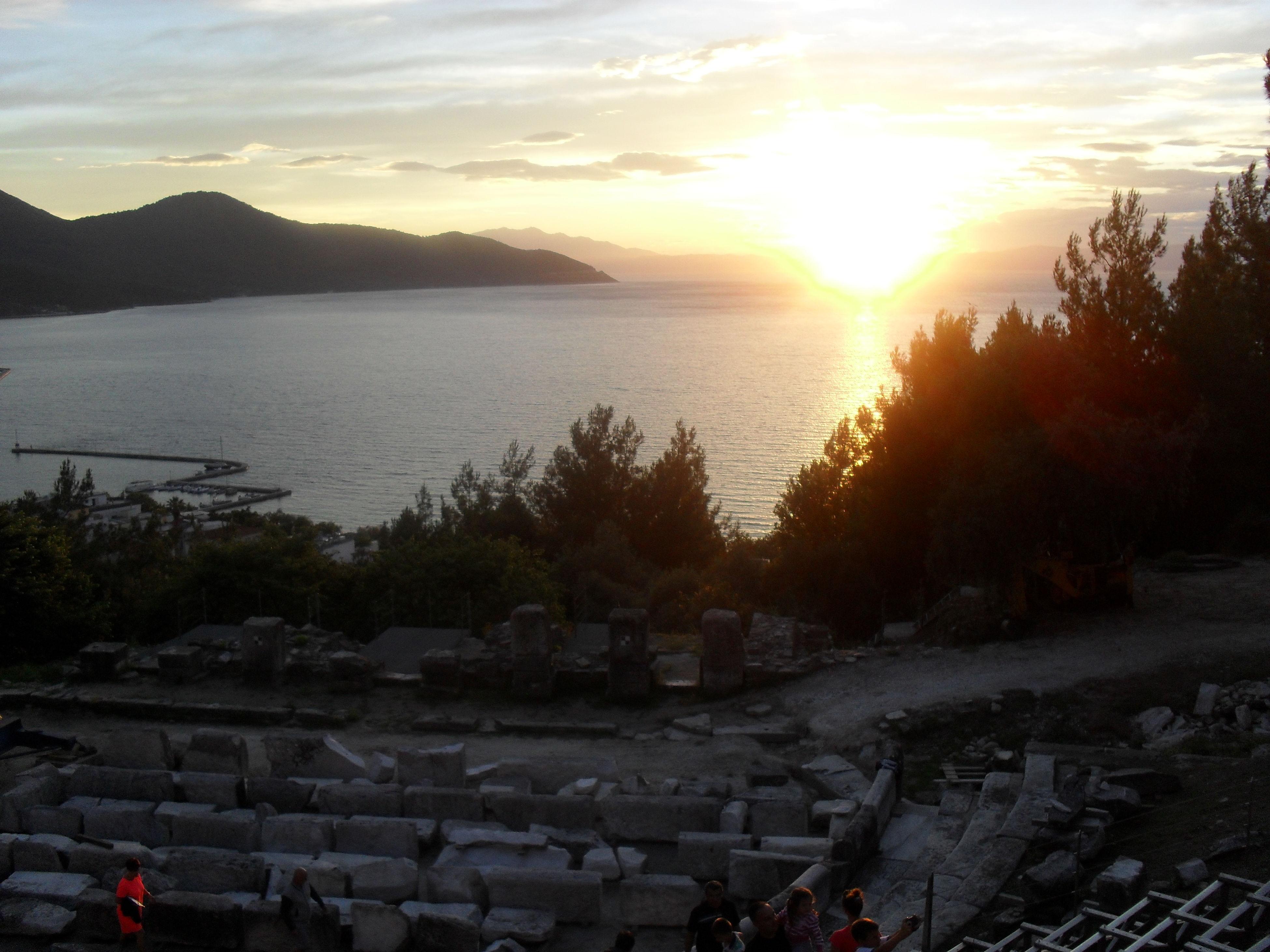sunset, water, sky, nature, beauty in nature, sea, sunlight, tree, sun, sunbeam, scenics, outdoors, mountain, no people, day