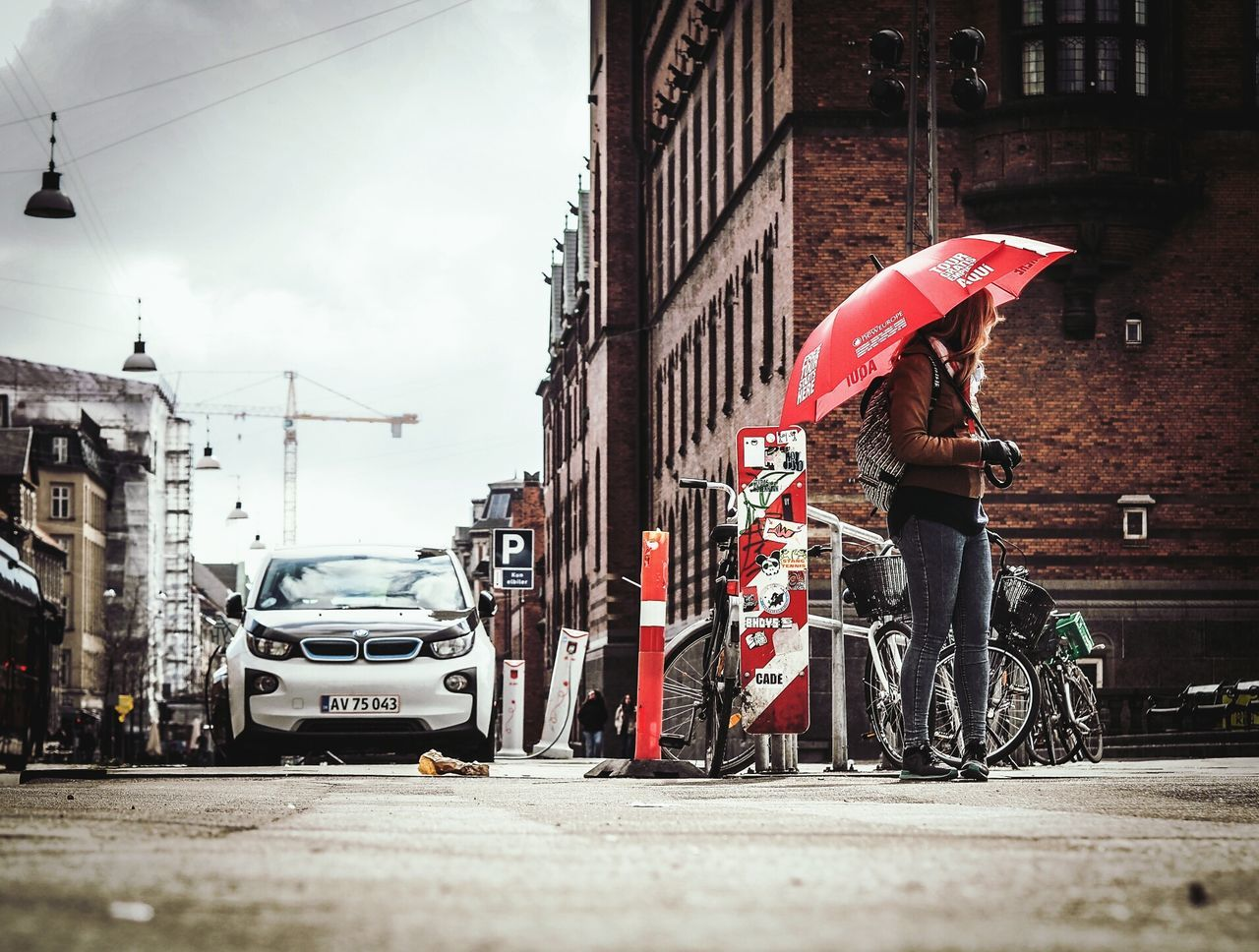 The red Umbrella 2/3 Here Belongs To Me Copenhagen From My Point Of View City Cityscape City Life Olympus OM-D E-M5 Mk.II Olympusomd Olympus Shootermag People People Of EyeEm People Watching Street Life Street Street Photography Streetphotography Woman Guide Umbrella Red Urban Low Angle View Urban Lifestyle Storytelling